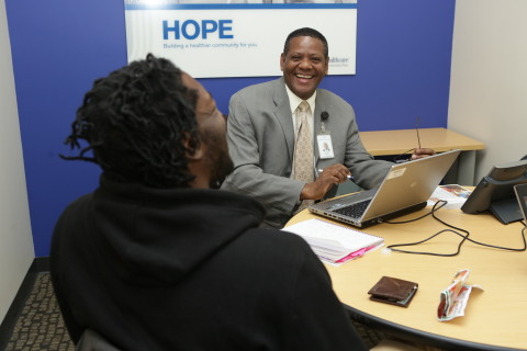 UnitedHealthcare's Rafael Batista meets with a customer interested in enrolling in a health insuranc ...