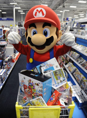 In this photo provided by Nintendo of America and released December 8, 2014, Mario stopped by a Best ...