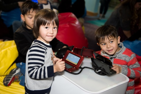 In this photo provided by Nintendo of America, kids and parents gather at TeenScape in Los Angeles P ...