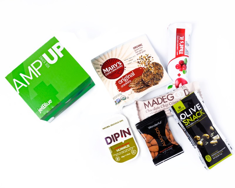 JetBlue's new AmpUp box: These healthful nibbles hit the trifecta of gluten-free, vegan and kosher, offering Marys Gone Crackers, red pepper hummus, a MadeGood chocolate crispy rice square, Greek olives, roasted almonds and a Thats It fruit bar. (Photo: Business Wire)