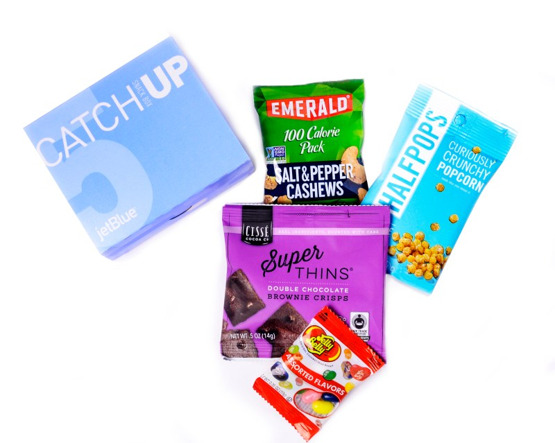 JetBlue's new CatchUp box: Catch up on your favorite shows and the latest blockbusters with these encore-worthy treats, including Emerald salt and pepper cashews, Halfpops crunchy popcorn, Ciss Cocoa brownie crisps and Jelly Belly jellybeans. (Photo: Business Wire)