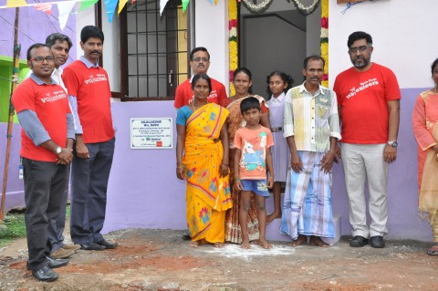 Wells Fargo team turns over keys to one of the flood affected families in a dedication ceremony orga ...