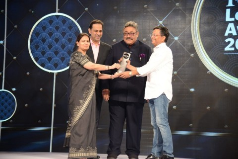 (L-R) Award presented by Ashu Suyash, CEO, CRISIL; Sanjiv Bajaj, MD, Bajaj Finserv and Rajiv Luthra, ...
