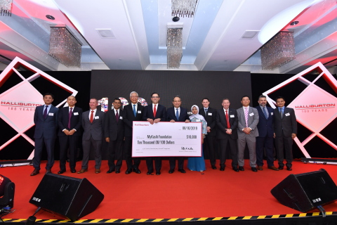 Halliburton Chairman, President and CEO Jeff Miller, joined by Halliburton Asia Pacific Region management, present a $10,000 grant to the MyKasih Foundation for their work to help low-income Malaysian families through food distribution and education. (Photo: Business Wire)