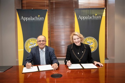 Professor Hassan Hamdan Al Alkim, the President of AURAK, and Dr. Sheri Everts, the Chancellor of Ap ...