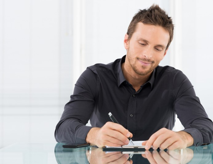 Businessman Writing Document