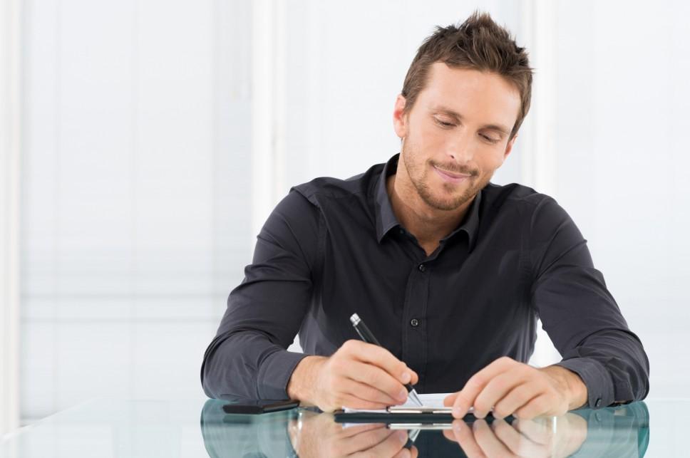 Businessman Writing Document