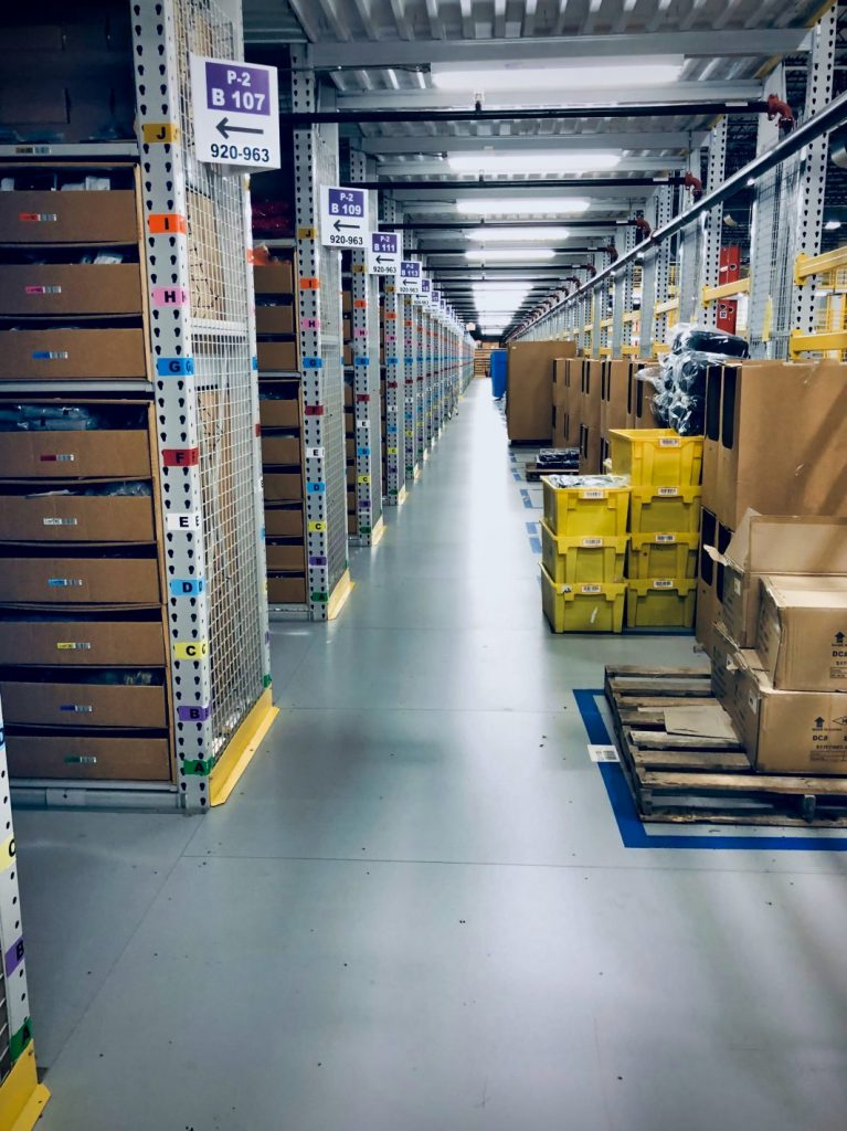Amazon aisles of bins of inventory