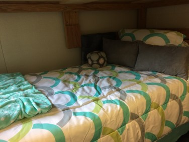 I have the bottom bunk, which is a little tight sometimes, but very cozy!
