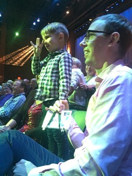 Child showing the auctioneer that he is 4 years old during the live auction of the 2018 Minnesota Made event