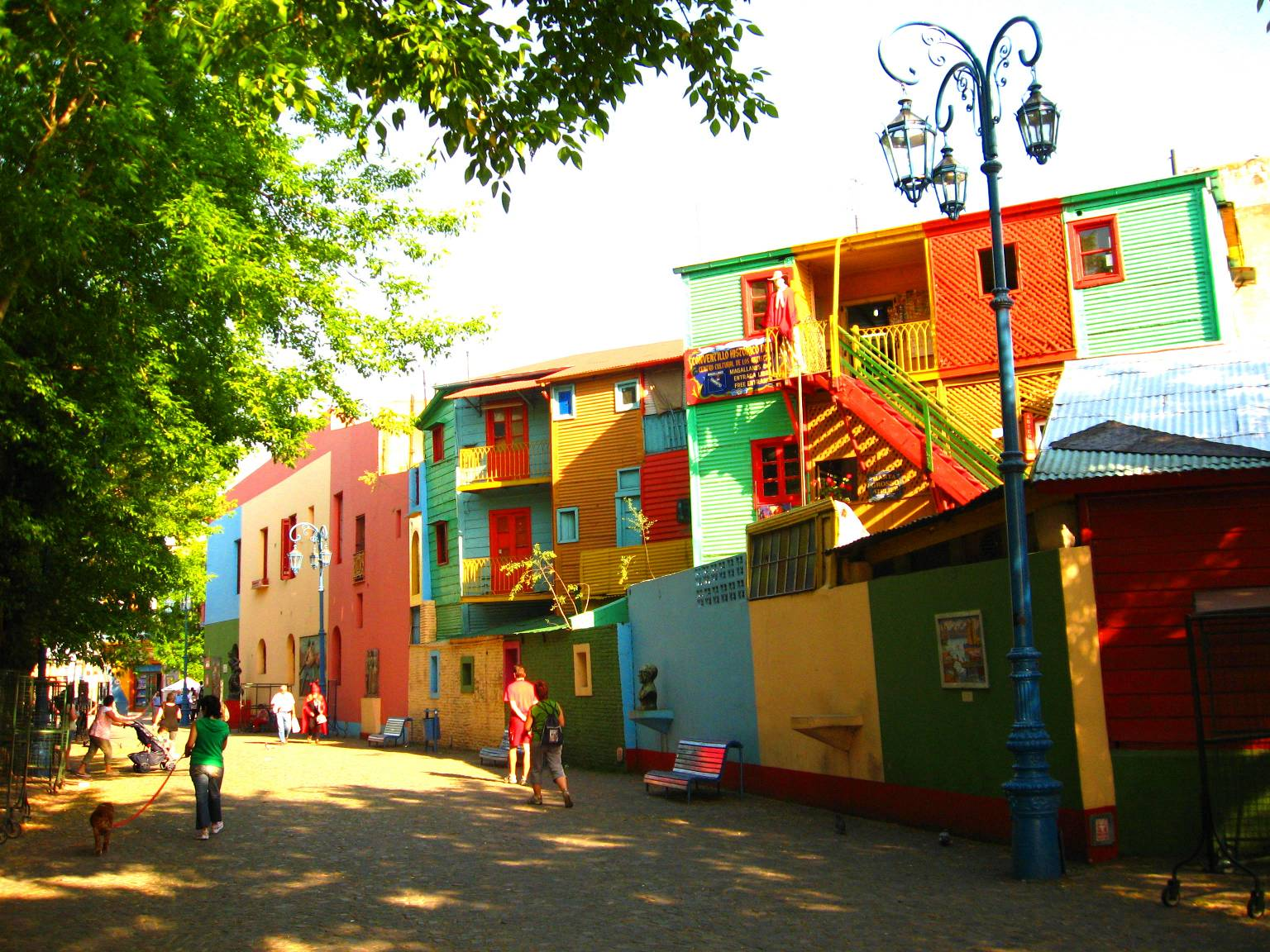 You'll find brightly-colored buildings in the La Boca neighborhood of Buenos Aires, Argentina. Although primarily a tourist destination today, the area is surrounded by houses with painted sheet walls of different colors. Photo by Miranda Helbling.