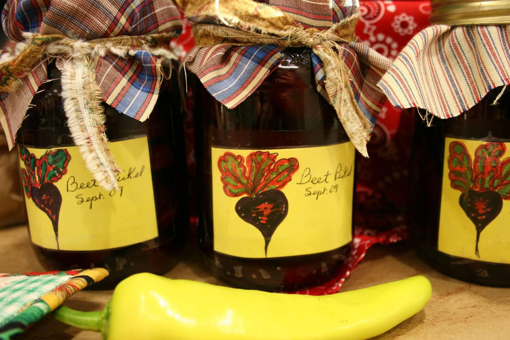 Jars of pickled beets on display.