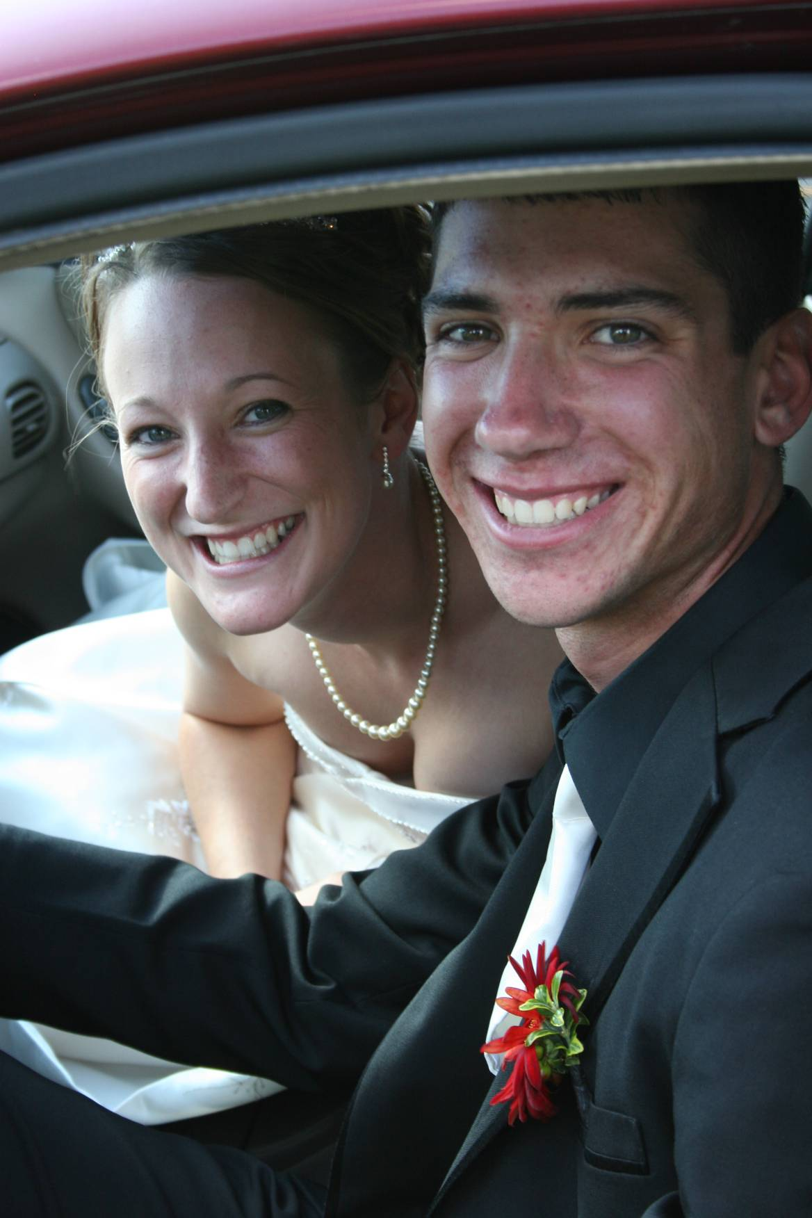 Leaving the church in the bridal car, Kristina and Corey.