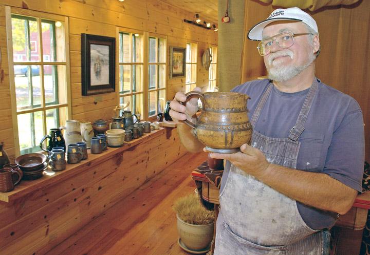 Gene Tokheim displays a piece of stoneware. Photo courtesy of Minnesota Office of Tourism.