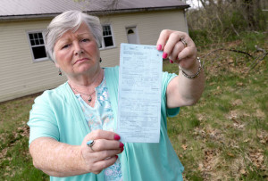 It took three Ministry of Natural Resources officers and an OPP officer to issue a $155 ticket to Cathy Copeland, 69, of Rondeau Provincial Park, for driving over tall grass prairie to get to St. Gabriel Catholic Church to clean the washrooms last Friday. Copeland and her husband Sid, 70, who has mobility issues, took the former pathway to the church when they couldn't get their vehicle past deep ponds of water at the front of the church. (Diana Martin, The Daily News)