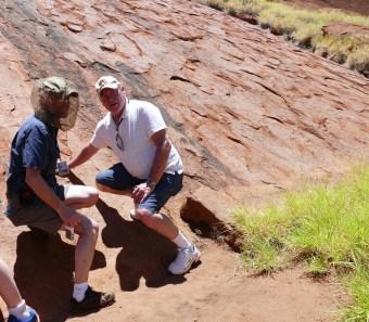 Touching scared Uluru