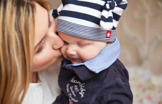 Baby-with-mom-kiss-tenderness