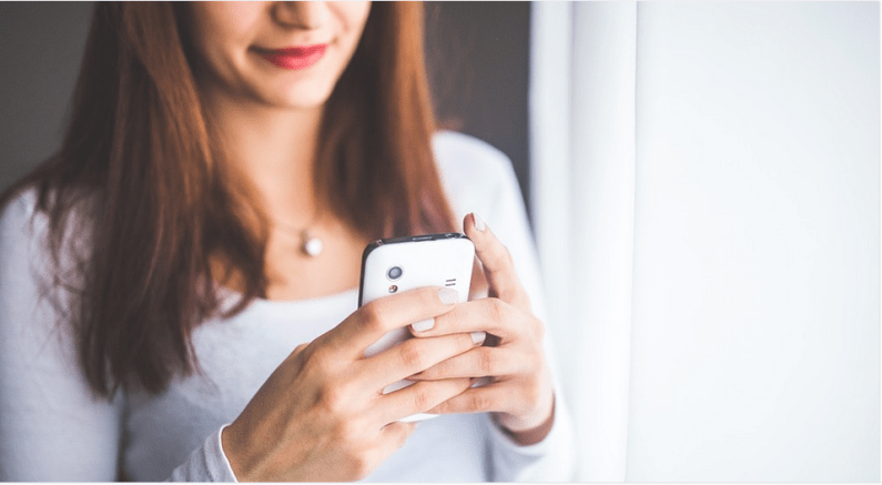 a young woman using phone
