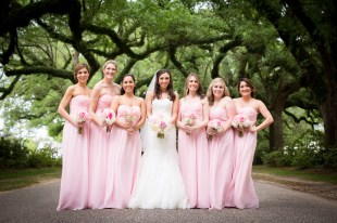 A bride and her bridesmaids at the Avenue of the Oaks
