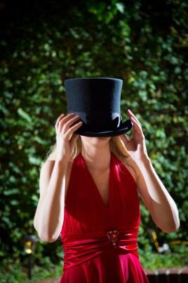 Girl wears too-big top hat