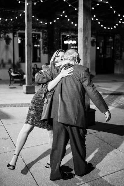 Father and daughter embrace as they dance