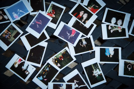 Instax photos scattered on a table