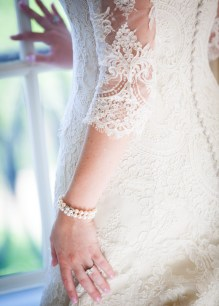 Heirloom pearls and a lace wedding dress