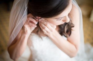 A bride puts on her earrings
