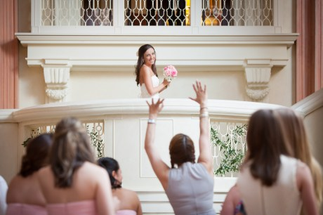 A bride prepares to toss her bouquet