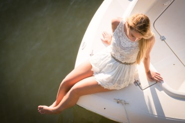 Overhead view of a blond high school senior on a boat