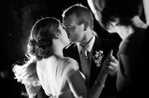 Groom steals a kiss on the dance floor