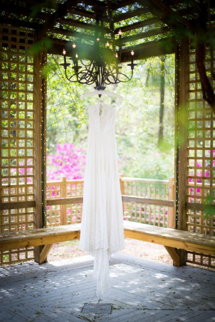 A bohemian chic wedding dress under the arbor
