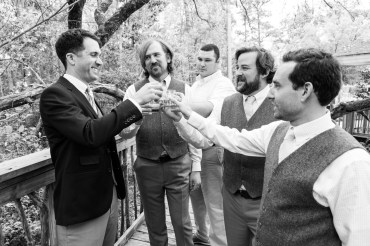 A groom toasts with his groomsmen