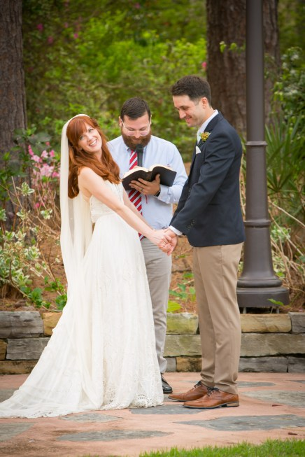 Beautiful bride and handsome groom say vows