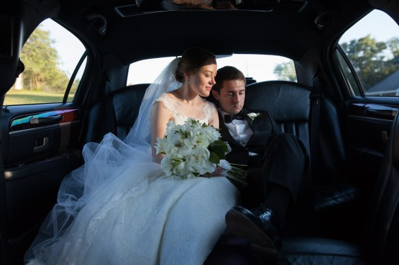 Monroeville bride and groom in limousine