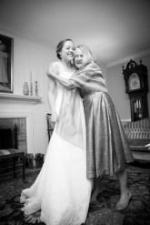 Mother hugs her daughter, the beautiful bride