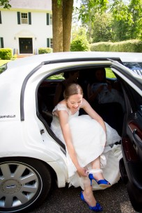 Bride puts garter on in limousine