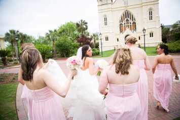 Bridesmaids escort a bride to St. Joseph's Chapel