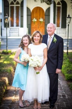 A happy family portrait outside a wedding chapel