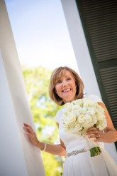 An excited bride waits outside the church