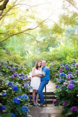 A couple among the blooming hydrangeas