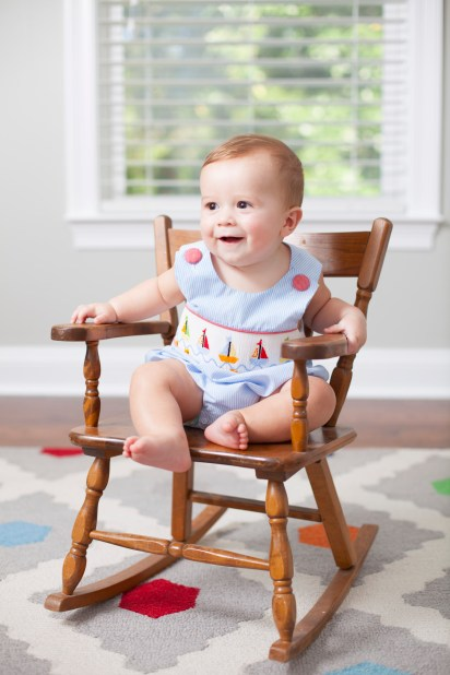 Six-month-old boy sits in a rocking chair