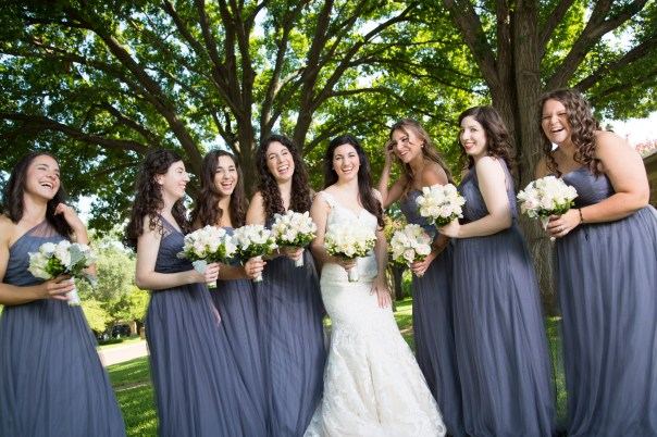 Bridesmaids laugh with the bride