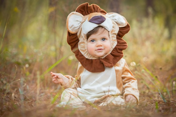 An adorable baby boy dressed as a lion