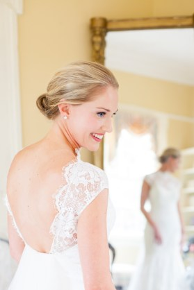 A stunning bride as she gets dressed on her wedding day