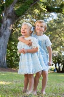 Blonde children dressed in blue