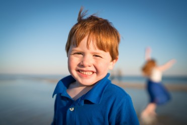 Ginger-headed boy at the beach