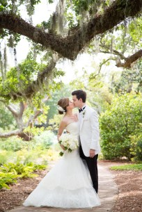 Bride and Groom kiss under the live oaks