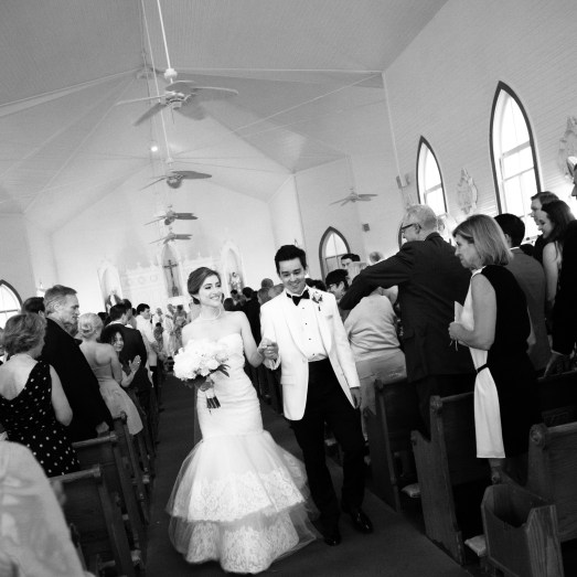Bride and groom exit Sacred Heart Chapel