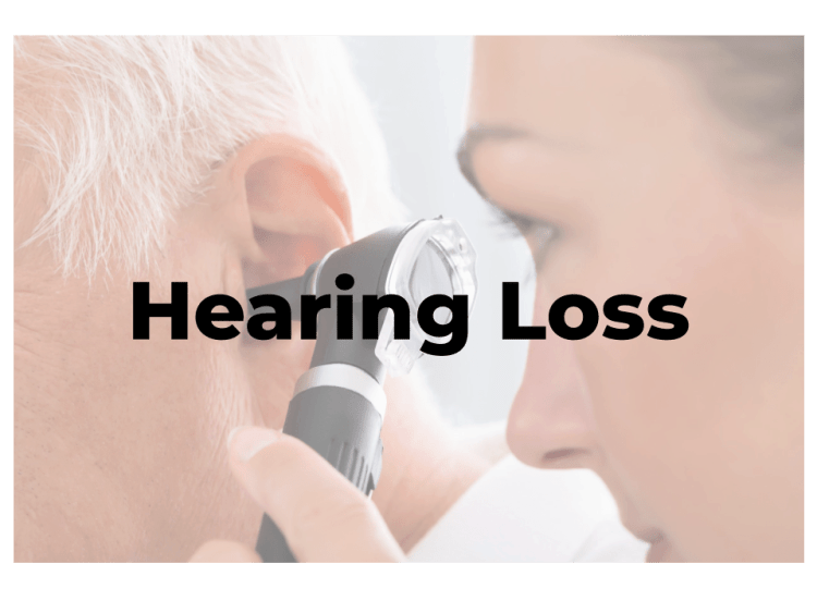 Specialist looking in the ear with an otoscope